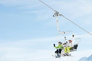 three people on a ski lift