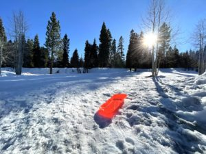 Red sled on sledding hill in Tahoe